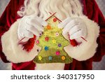 Santa Claus Holding Knitted...
