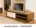 Close up of living-room with TV set and cupboard. - stock photo