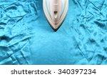 iron on crinkle silk fabric | Shutterstock . vector #340397234