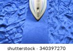 iron on blue crinkle silk fabric | Shutterstock . vector #340397270