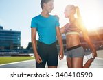 young runner stretching her... | Shutterstock . vector #340410590
