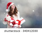 Smiling Young Woman In Santa...
