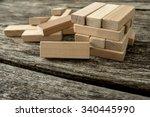 blank wooden block leaning on a ... | Shutterstock . vector #340445990