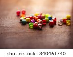 colorful beads on old wooden... | Shutterstock . vector #340461740