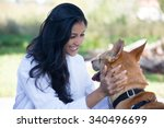 Stock photo closeup portrait sweet moments healthcare professional in white lab coat with dog isolated sunny 340496699