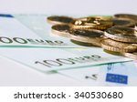 euro banknotes and coins on...