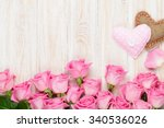 Stock photo valentines day card with pink roses and handmaded toy hearts over wooden table top view with copy 340536026