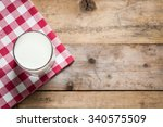 milk in a glass on a wooden... | Shutterstock . vector #340575509