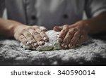 Close Up Of Woman Baker Hands...