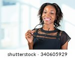 young african woman holding her ... | Shutterstock . vector #340605929