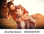loving couple hugging outdoors... | Shutterstock . vector #340606934