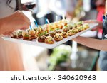 waiter carrying plates with... | Shutterstock . vector #340620968