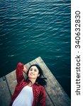 girl enjoy on lake jetty | Shutterstock . vector #340632830