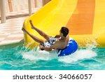 boy having fun in aqua park on... | Shutterstock . vector #34066057
