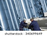 oil and gas workers with pump... | Shutterstock . vector #340699649