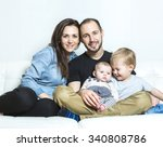 a young happy family with two... | Shutterstock . vector #340808786