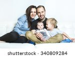 a young happy family with two... | Shutterstock . vector #340809284