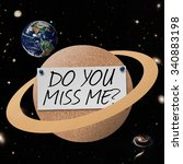 Small photo of Planet cork board with text Do you Miss Me? Elements of this image furnished by NASA