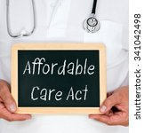 Small photo of Affordable Care Act - Physician holding blackboard with text