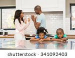 parents arguing in front of... | Shutterstock . vector #341092403