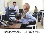Businesswoman Working At Desk...