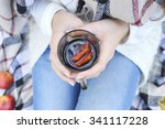 young woman drinking hot mulled ... | Shutterstock . vector #341117228