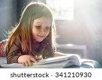 cute girl reading at home | Shutterstock . vector #341210930