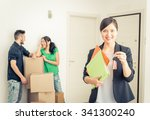 Small photo of Real estate agent portrait with family getting new home. business concept about real estate market