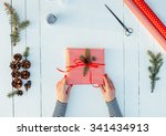 present wrapped in red paper on ... | Shutterstock . vector #341434913