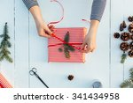 gift wrapping. woman packs... | Shutterstock . vector #341434958