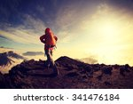 young woman backpacker hiking... | Shutterstock . vector #341476184