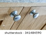 Stock photo close up of kitchen cabinet door knobs 341484590