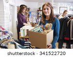 woman donating unwanted items...   Shutterstock . vector #341522720