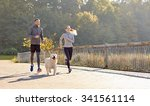 Stock photo fitness sport people and lifestyle concept happy couple with dog running outdoors 341561114