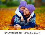 Joyful Father And Son Having...