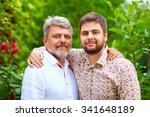 Portrait Of Happy Father And...