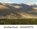 a concrete road towards... | Shutterstock . vector #341695574