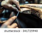Jeweler Crafting Jewelry On Hi...