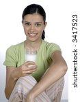 girl holding glass with milk | Shutterstock . vector #3417523
