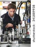 engineer working on machine in... | Shutterstock . vector #341889938