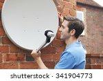 Man Fitting Tv Satellite Dish...