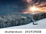 Stock photo colorful winter evening in the mountains at sunset dramatic overcast sky and snowing view of the 341919008