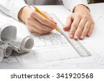 architect working on blueprint. ... | Shutterstock . vector #341920568