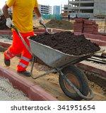work carries fertile soil in a...   Shutterstock . vector #341951654