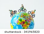 Miniature People Riding Bicycl...
