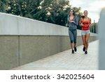 women jogging in city in dusk... | Shutterstock . vector #342025604