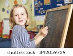 young girl writing on... | Shutterstock . vector #342059729