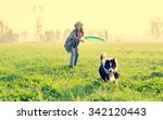 Stock photo young beautiful girl throwing to her dog in a park at sunset asian woman playing with her dog 342120443