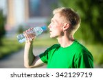 tired man drinking water from a ... | Shutterstock . vector #342129719
