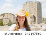 Portrait Of Female Tourist Wit...